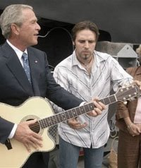 Bush plays the guitar while New Orleans drowns