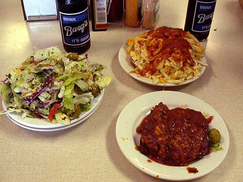Wop salad, macaroni and cheese with red gravy, braciole.