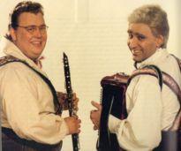 I'm Yosh Shmenge ... and I'm Stan Shmenge!  And we're the Happy Wanderers!